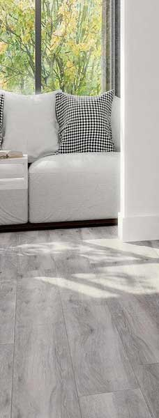 Grey Wood Effect Floor Tiles and Couch in Beautiful Home grande