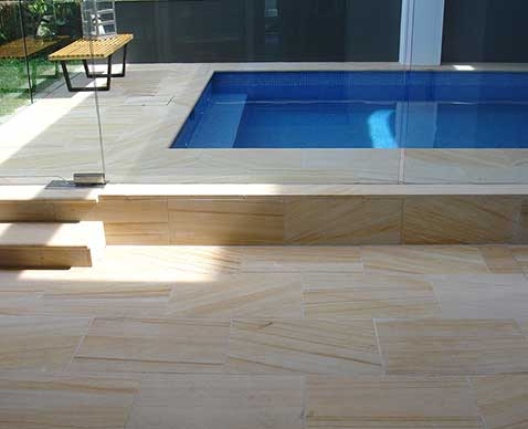 Beautiful modern swimming pool sandstone tiles